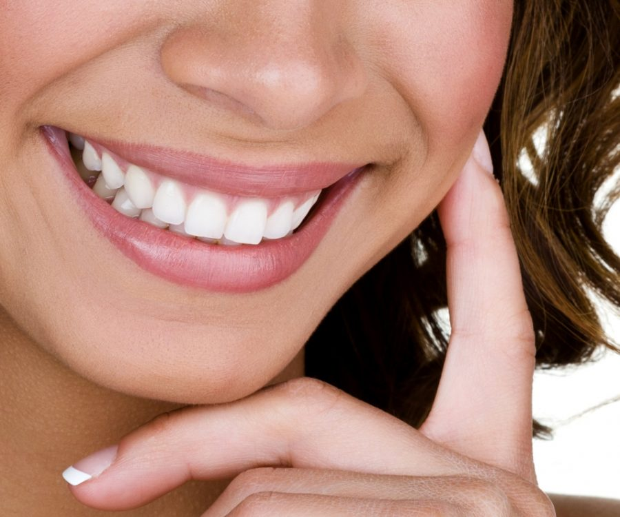 Closeup of a woman with perfect teeth smiling